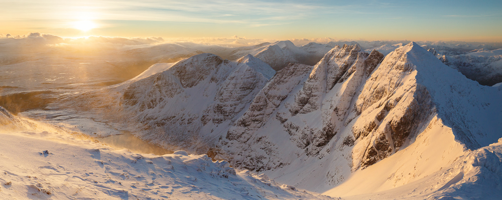 A panorama of An Teallach looking into the rising sun