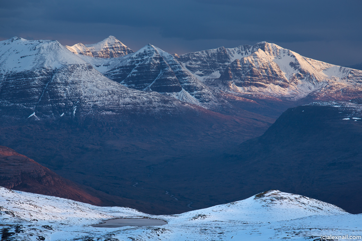 Liathach with its summits Spidean a' Choire Leith and Mullach an Rathain (which I hiked in August) catch some early morning sunshine behind Beinn Eighe.
