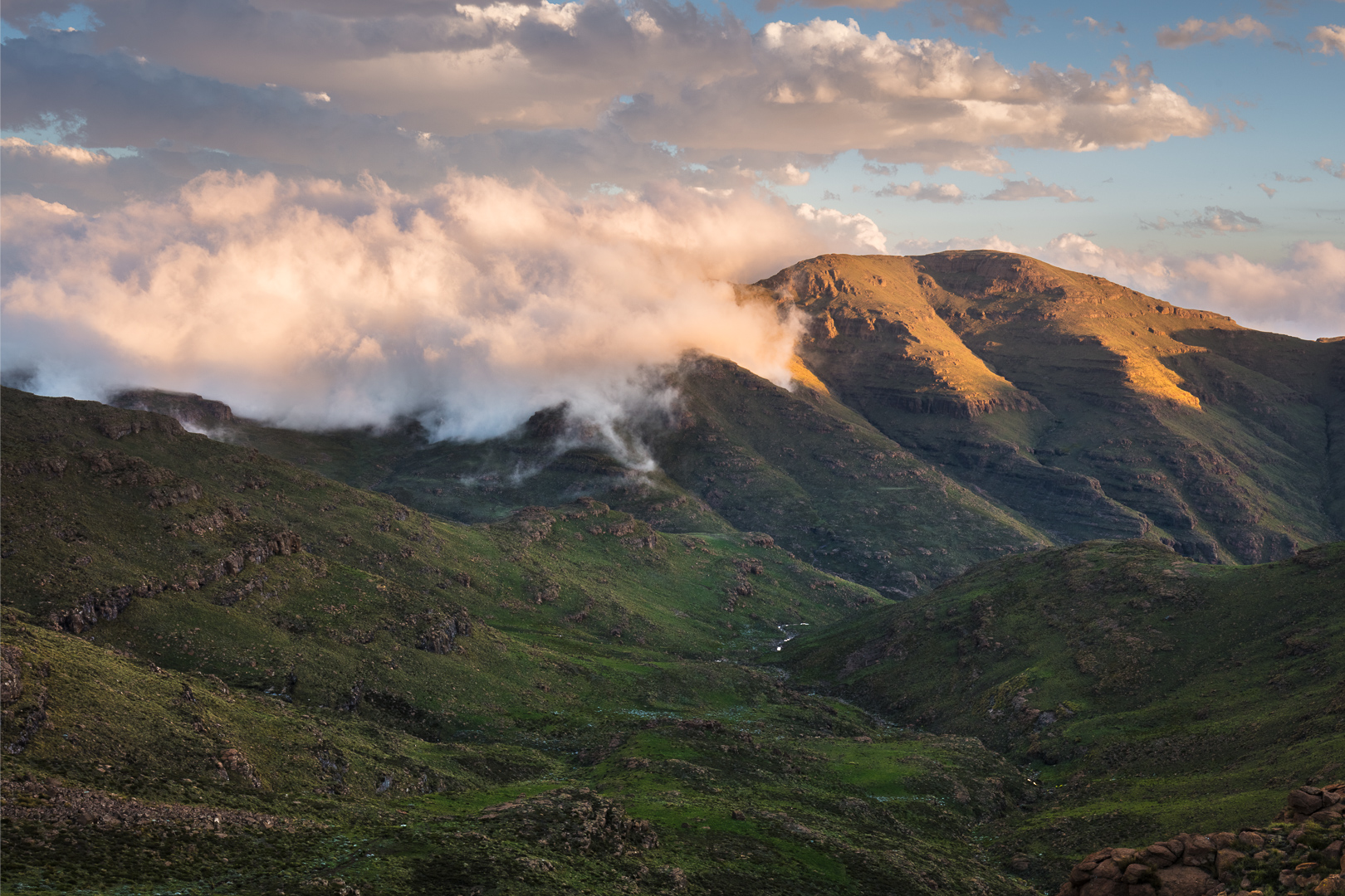 Last light on the hills of Lesotho. Sadly Cleft Peak was clouded out for sunset.