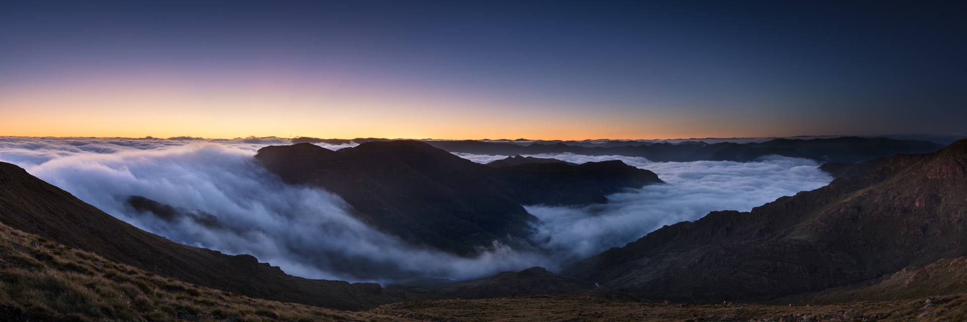 An early morning inversion encircles the flanks of the Ndemeni Dome. As seen from Cleft Peak. This is the first time I have seen an inversion get over the escarpment (which is making the edge of the wave on the left) and into the hills of Lesotho