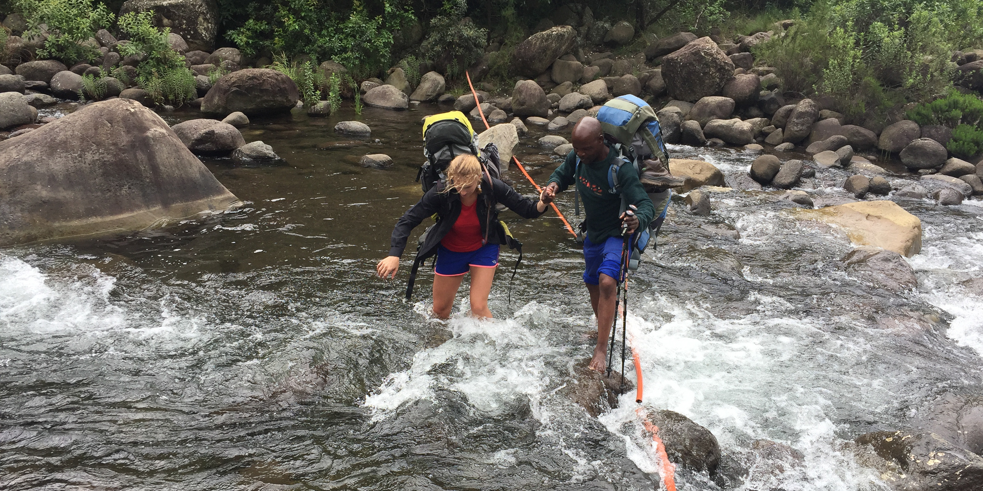 Jeffrey giving Milly a helping hand across the first and only river crossing of the trip. The boulders and fast current made it surprisingly tricky underfoot. After rain this would soon become impassible.