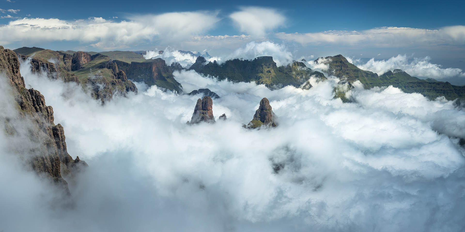 I have seen many spectacular sights in the Drakensberg, so it is hard to pick favourites, but this certainly ranks among them. In the centre is Pyramid and Column and at the back the Cathedral Ridge. This is actually taken from 100m or so below the summit of Cleft Peak but it gives a much better overlook than the summit itself.