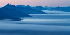 Sea mist drifts south from Lofoten into the Norwegian sea at night