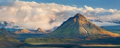 Hattfell rises above the dramatic plains of Iceland with big clouds behind