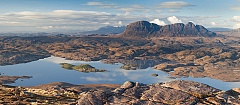 sunshine over assynt from Stac pollaidh on a clear day
