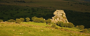 Stong sunlight hits Vixen Tor on Dartmoor
