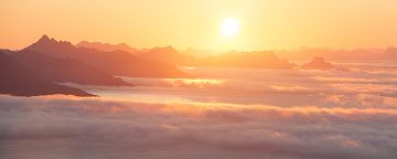 Sunrise over sea mist in Lofoten