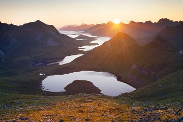 The sun rises over Selfjorden in Lofoten