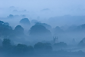 blue mist surrounds mary tavy church in Devon