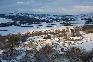 sunlight hits the devon village of Peter Tavy in the snow