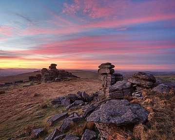 a vivid pink sunset over staple tor