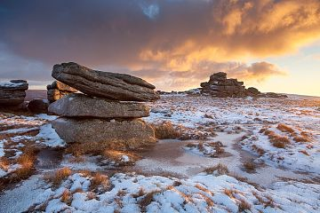 Fur Tor on Dartmoor with the sky lit up by the rising sun