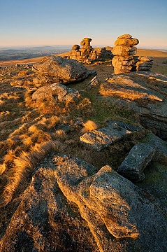 Golden light at sunrise on Staple Tor with a clear blue sky and excellent visibility