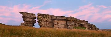pink clouds behind Watern Tor at sunrise